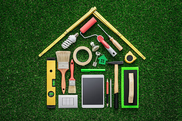 Assorted tools laid out in the shape of a house